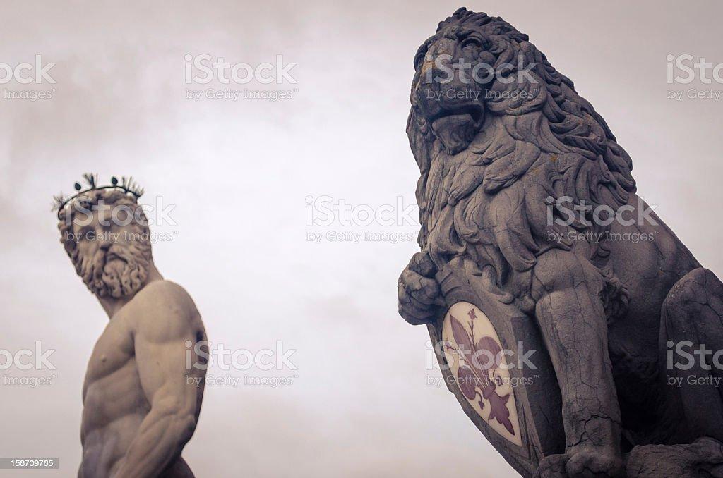 Florence's lion and Neptune fountain in Piazza della Signoria royalty-free stock photo