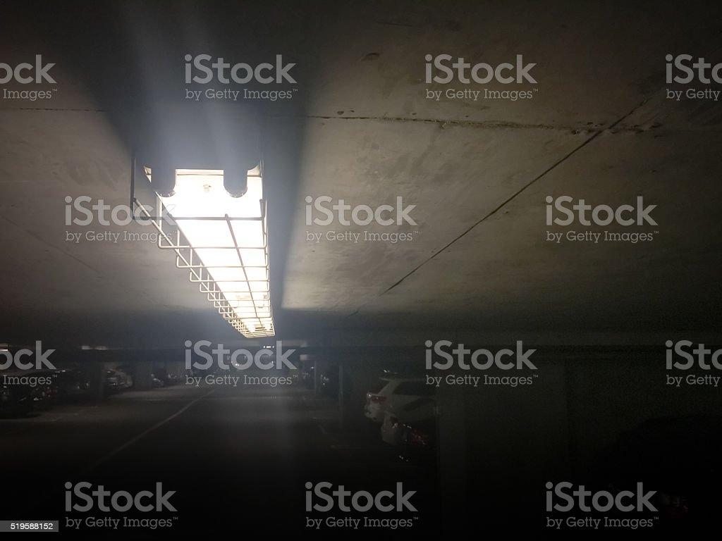 Florescent ceiling light in underground garage stock photo