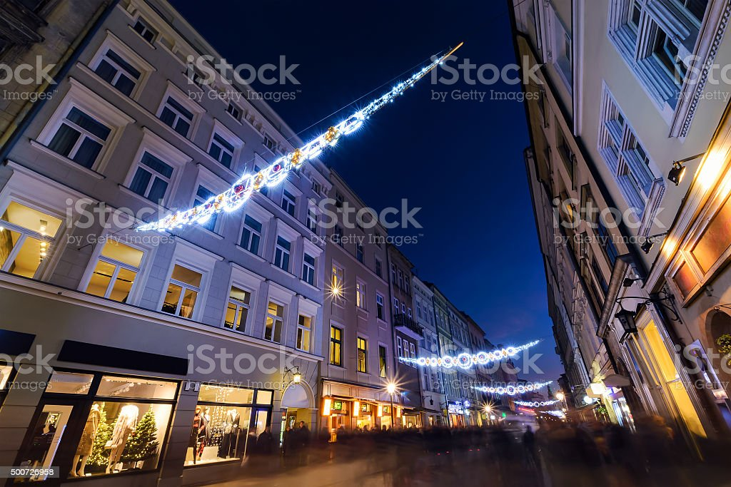 Florianska street in Krakow, decorated by the christmas lights. stock photo