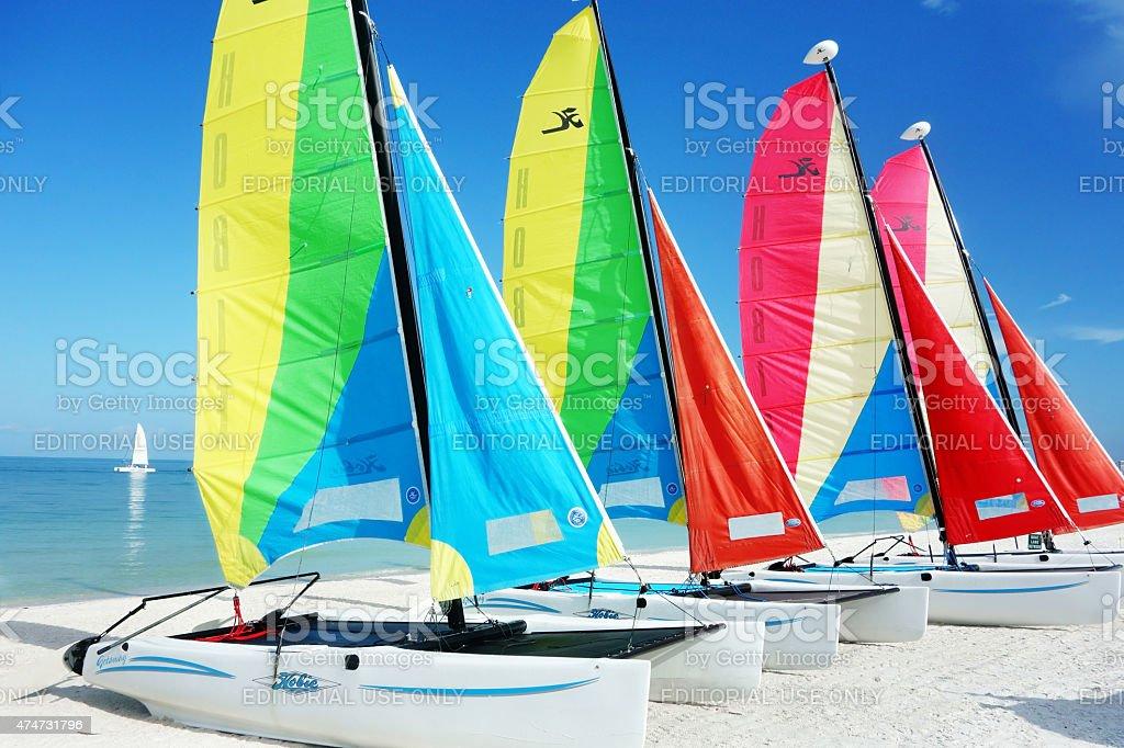 Florida beach with Hobie Cat catamaran sailboats stock photo