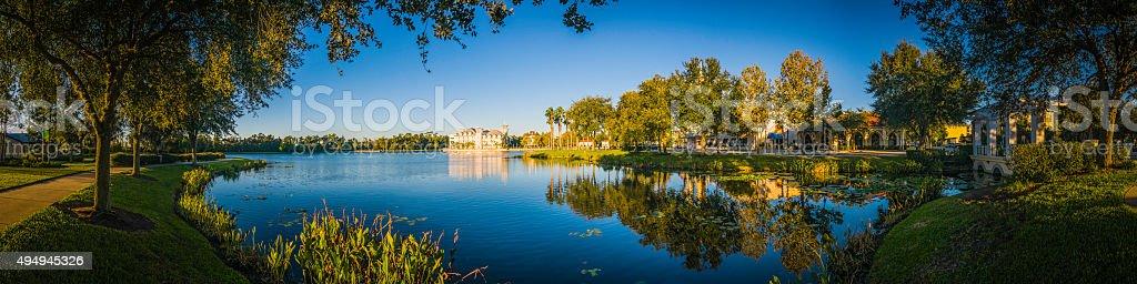 Florida blue lakeside living tranquil summer suburban homes sunrise USA stock photo