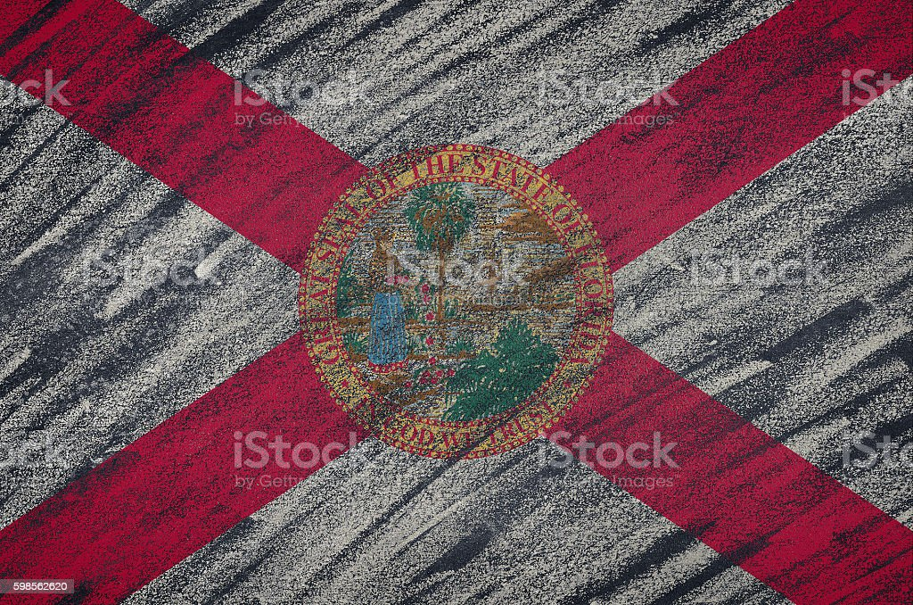 Florida flag painted with colored chalk on a blackboard. stock photo