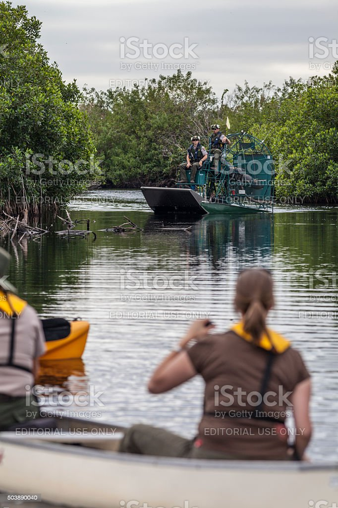 Florida Park Rangers on an Airboat and Canoe stock photo