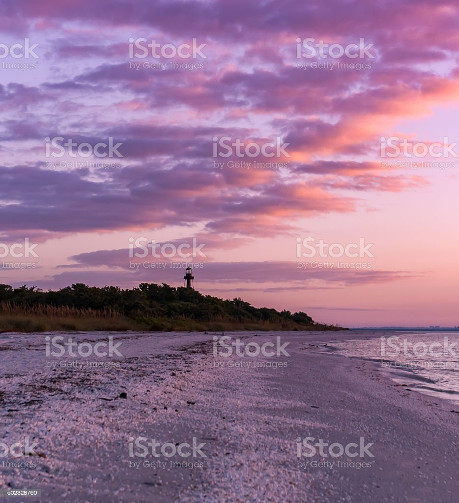 Florida Sunrise on Ocean and Lighthouse stock photo