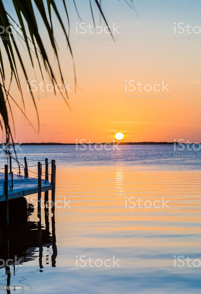 Florida sunset with gentle ripples in water stock photo