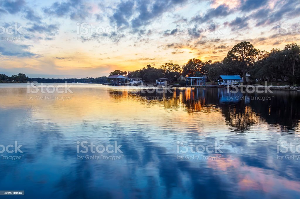 Florida Waterfront Homes and Boathouses at Sunset stock photo