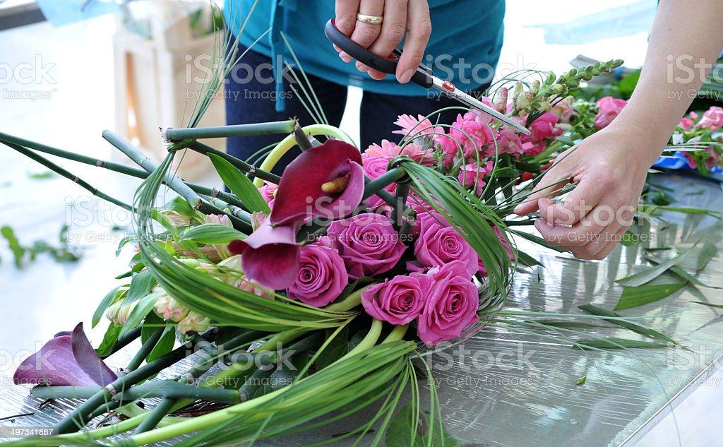 Florist makes flowers bouquet stock photo