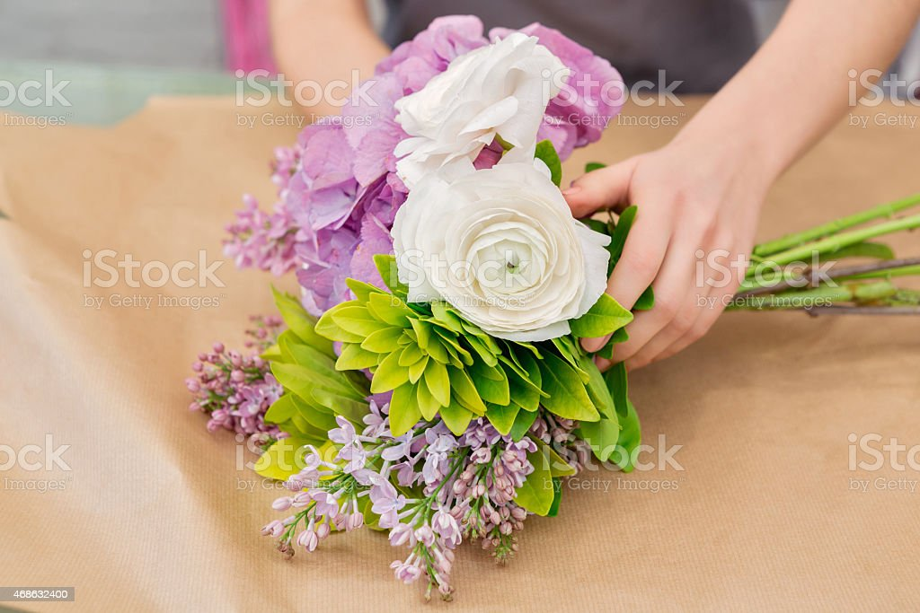 Florist making a flower arrangement stock photo