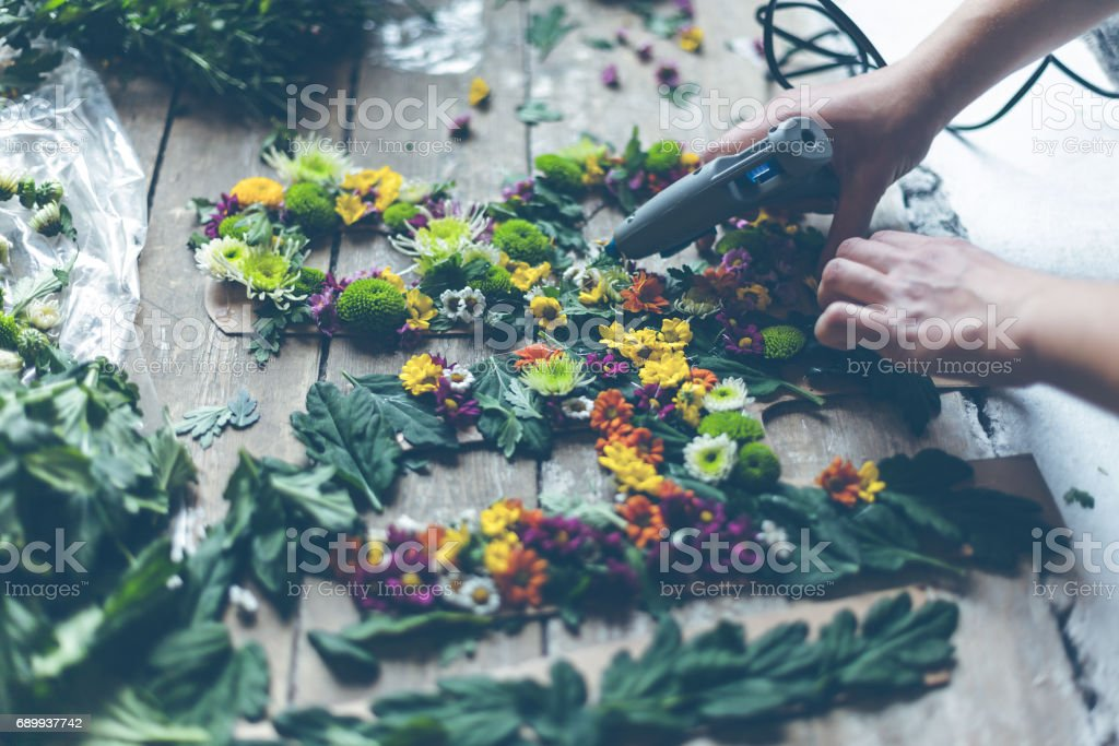 Florist making flower decoration stock photo
