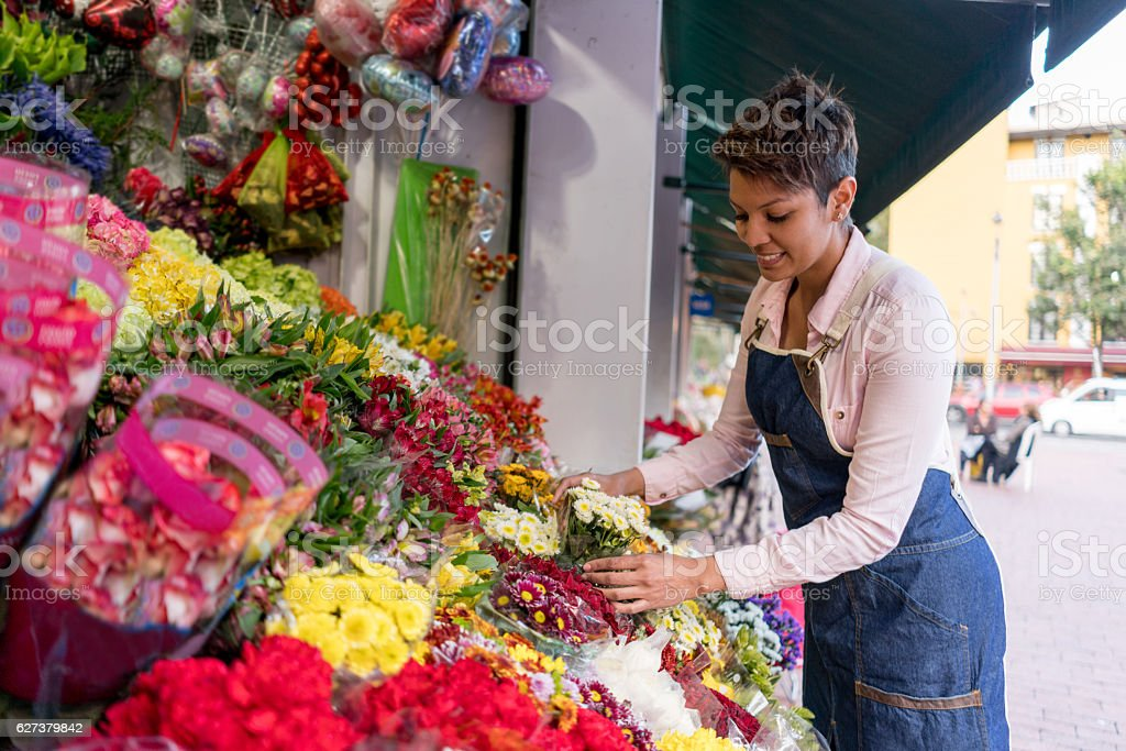 Florist organizing flowers - small business stock photo