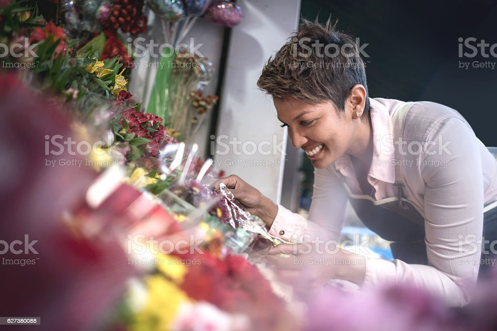 Florist owner looking very happy stock photo