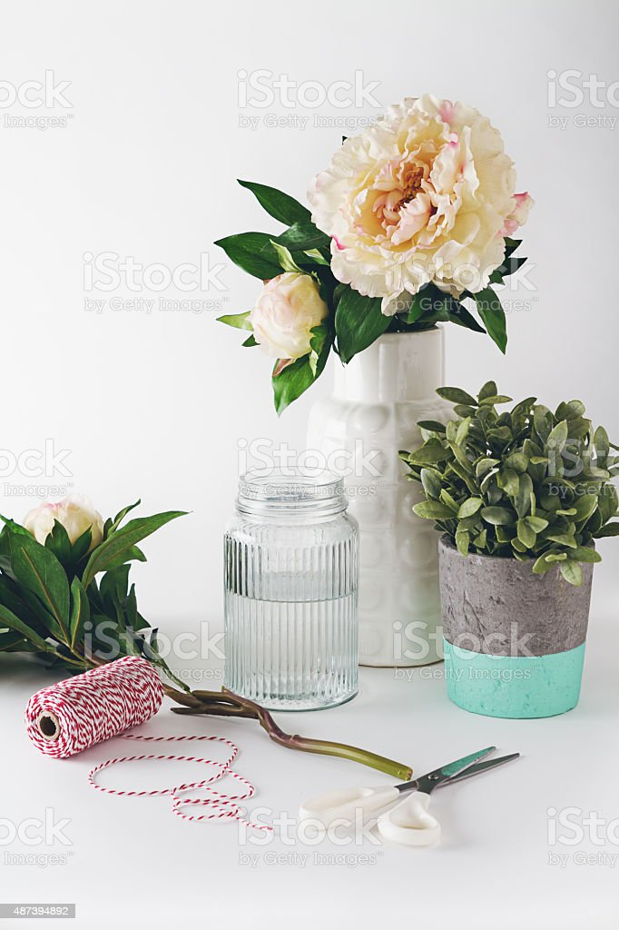 Florist preparation with selection of vases scissors and string stock photo