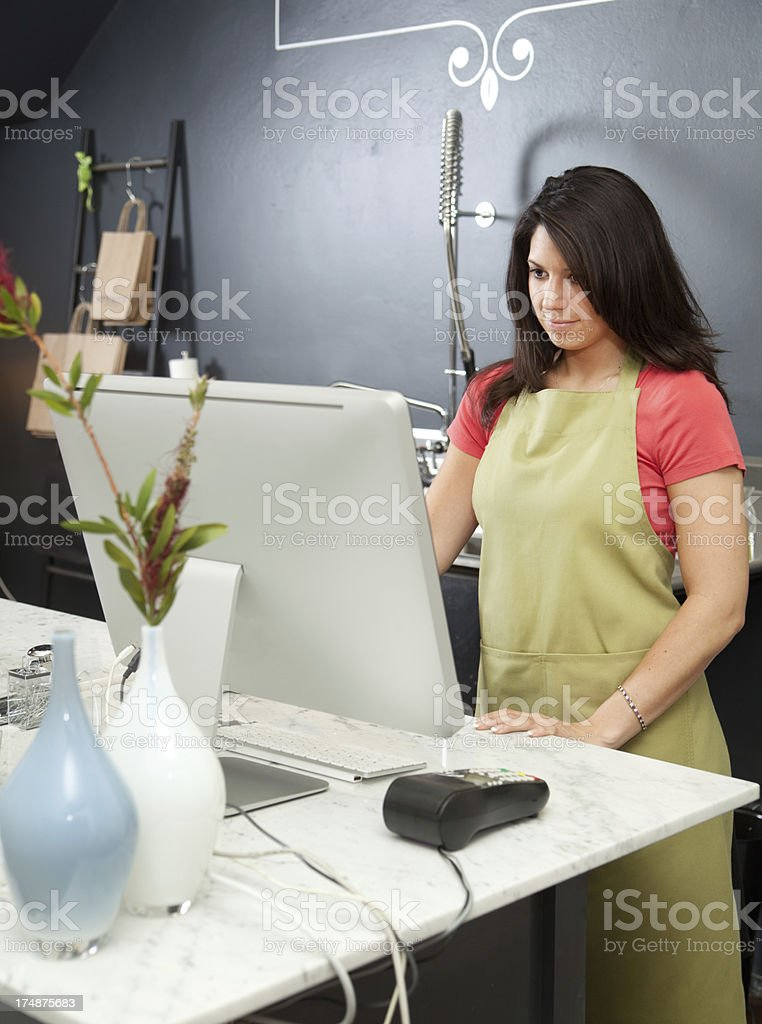 Florist Small Business Owner Working in Flower Shop Retail Store royalty-free stock photo