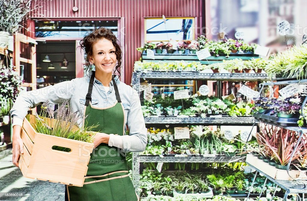 Florist standing at her shop stock photo