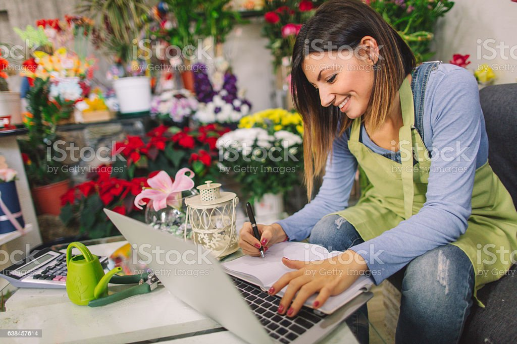 Florist taking orders from the internet stock photo