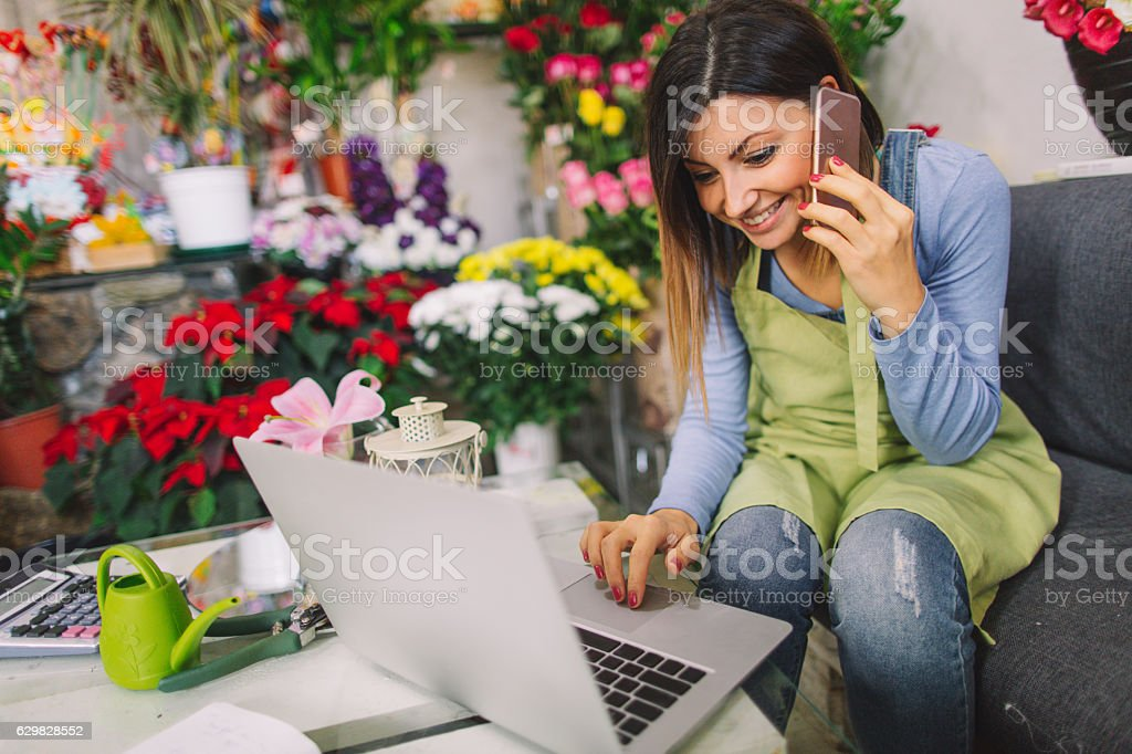 Florist taking orders on the phone stock photo