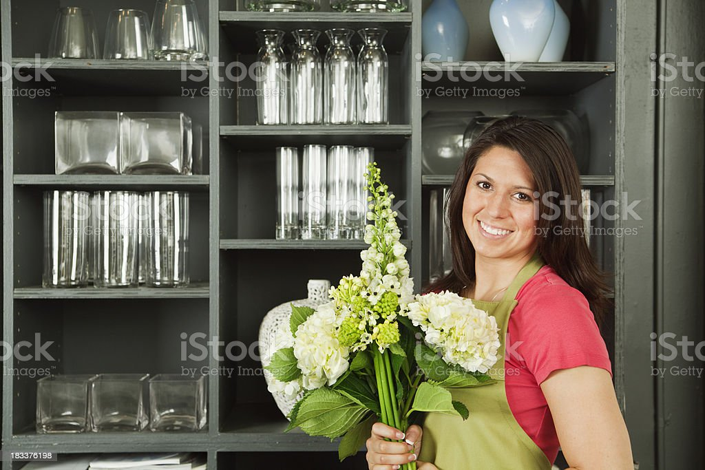 Florist with Bouquet of Flower in Shop Display Hz royalty-free stock photo