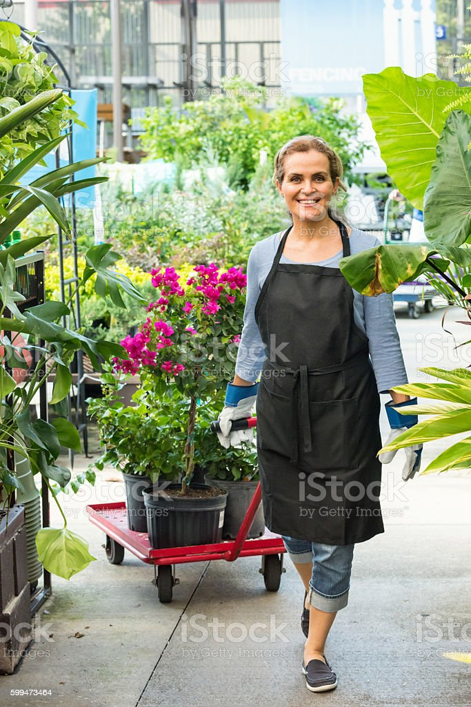 Florist working at a nursery stock photo