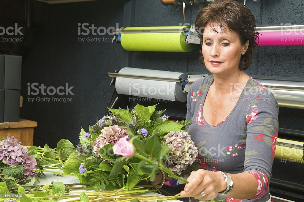Florist working in a store royalty-free stock photo