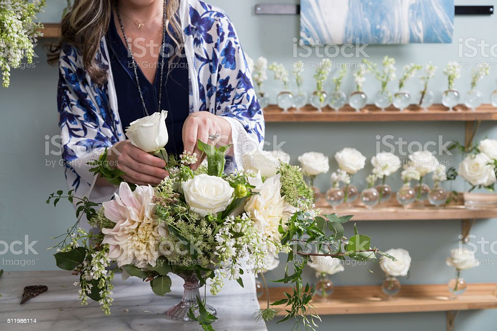 Florist Working in Her Shop stock photo