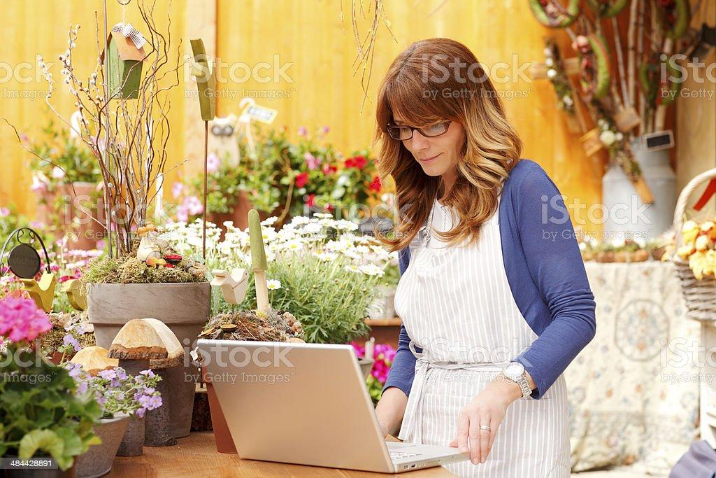 Florist working on laptop stock photo