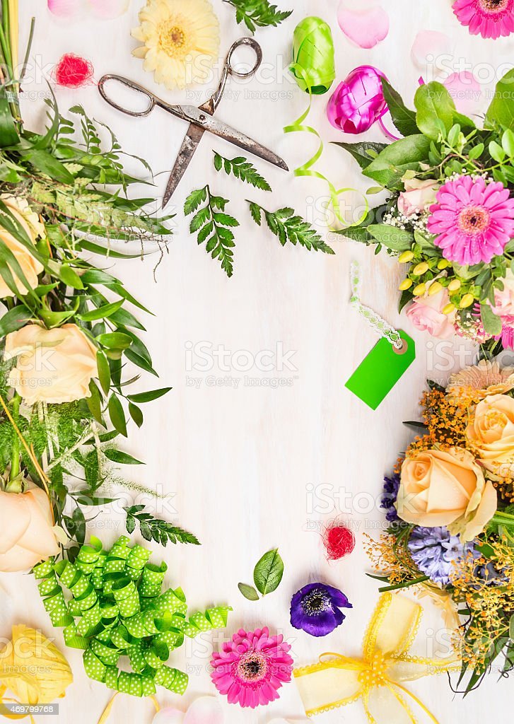 Florist workplace with retro scissors, and  accessories on white wooden stock photo