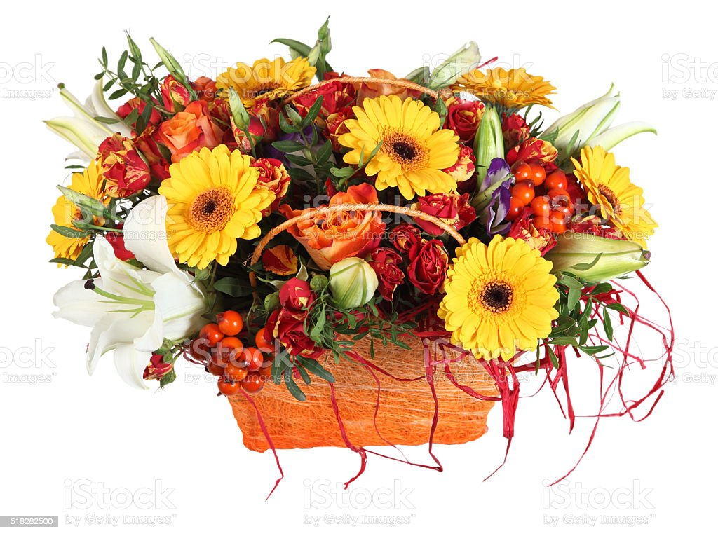 Floristic composition in basket, orange roses, yellow gerbera, white lilies. stock photo