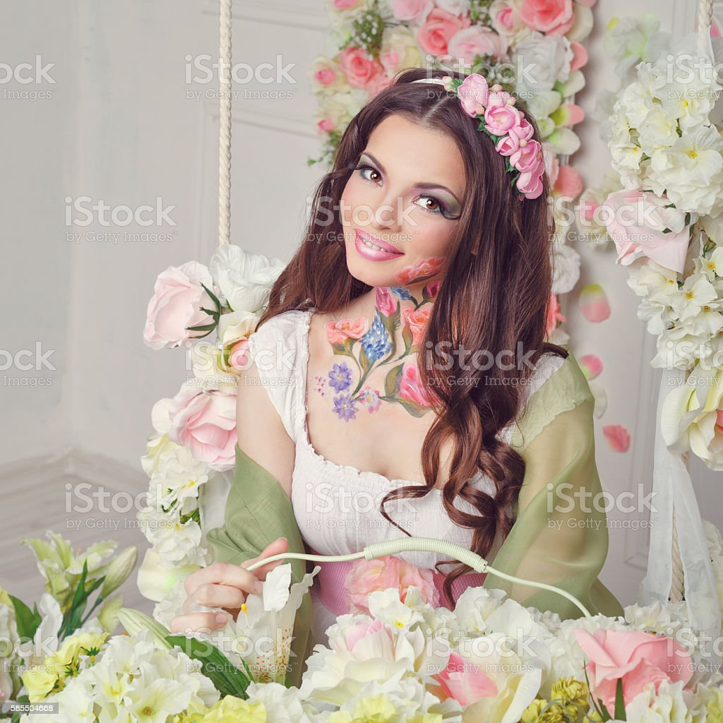 Floristry girl with face art. stock photo