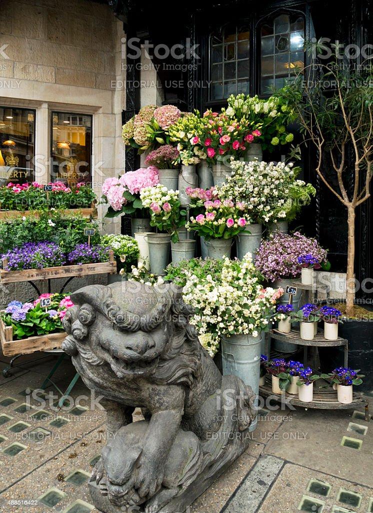 Florist's stall outside Liberty's of London stock photo
