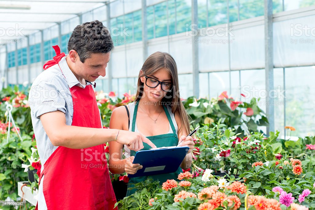 Florists Working in Them Store stock photo