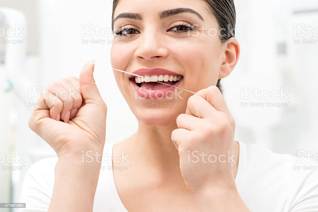 Floss its help me to care my teeth. stock photo