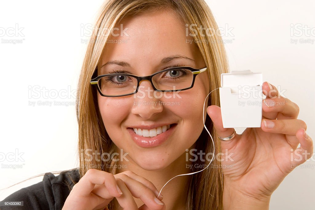 Floss your teeth stock photo