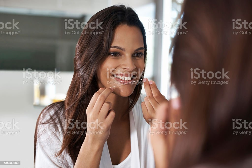 Flossing is part of her morning routine stock photo