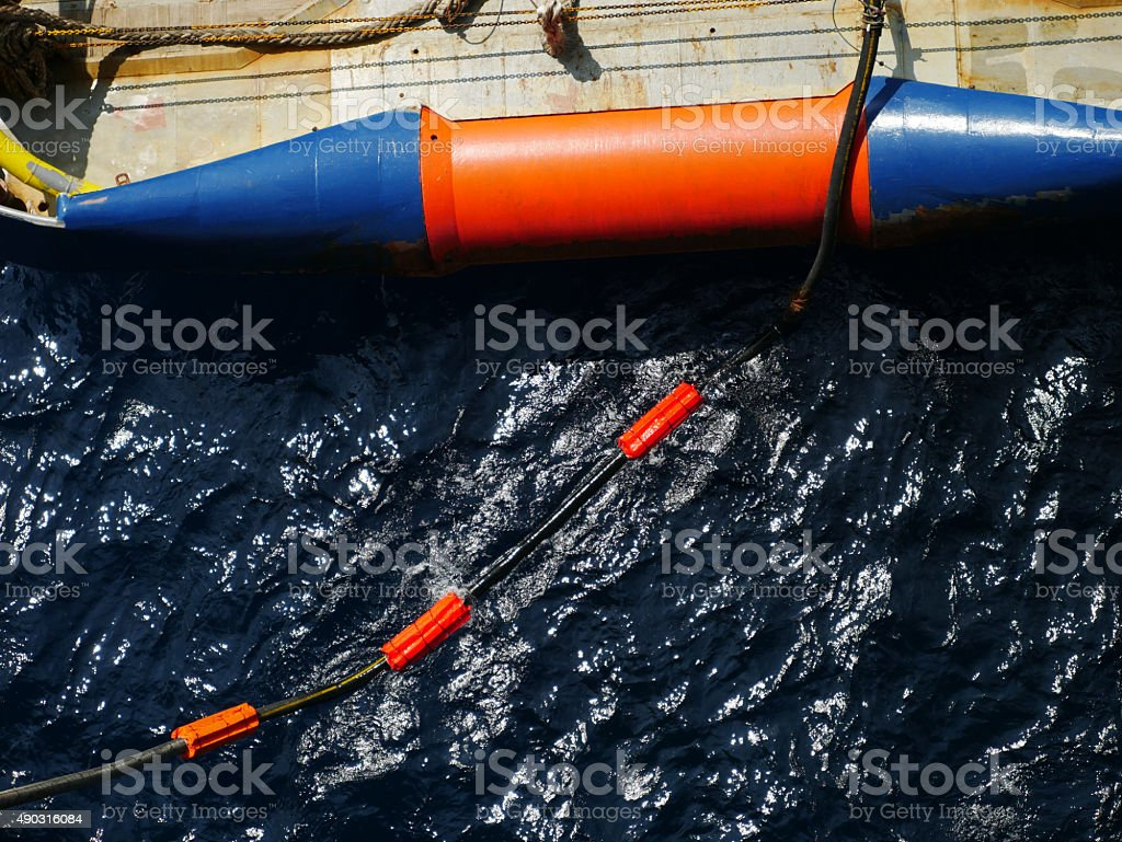 Flotation collars at the back of offshore supply vessel stock photo