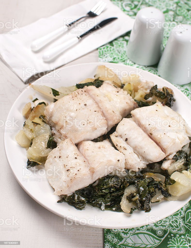 Flounder fillet on bok choy cabbage royalty-free stock photo