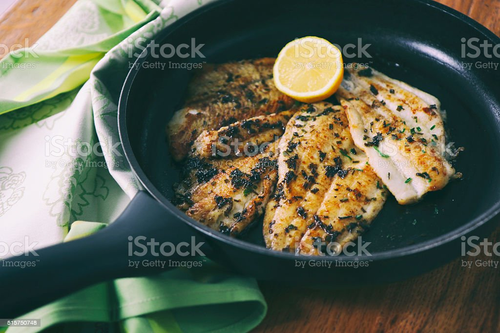 Flounder fillet roasted in a skillet stock photo