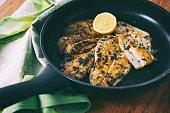 Flounder fillet roasted in a skillet