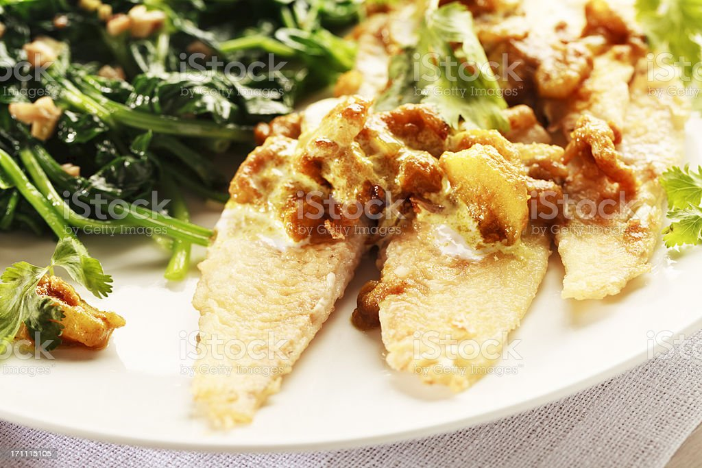 flounder with indian style sauce and spinach royalty-free stock photo