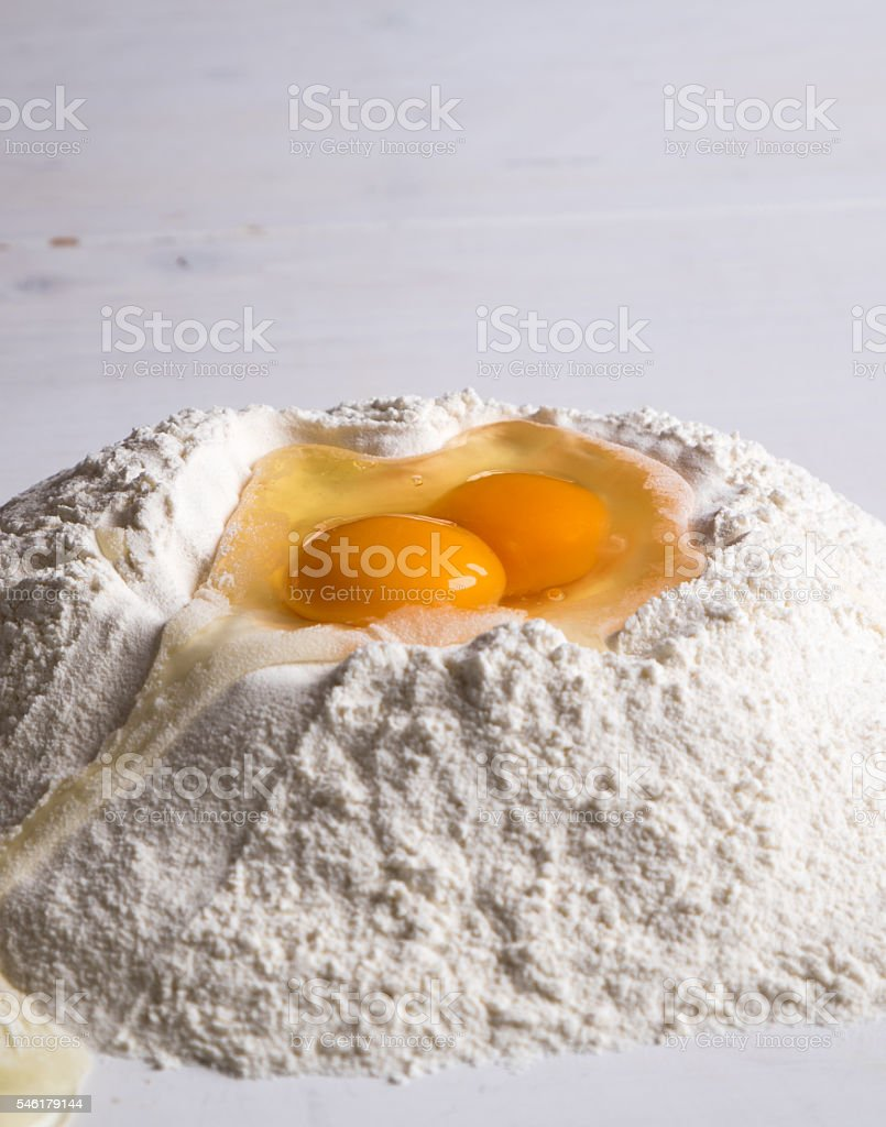 flour and egg on table stock photo