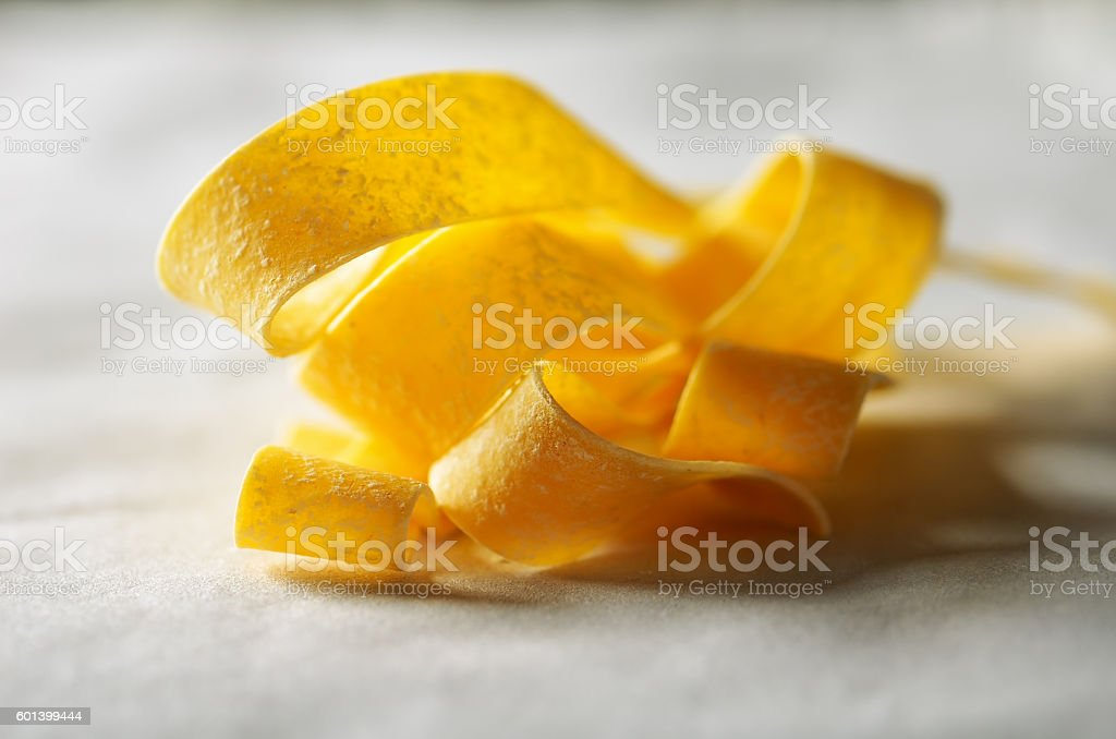 flour and pasta on a light background close-up horizontal stock photo