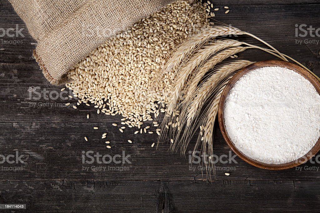 Flour and wheat grains stock photo
