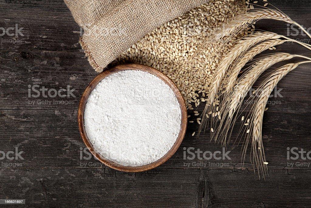 Flour and wheat grains stock photo