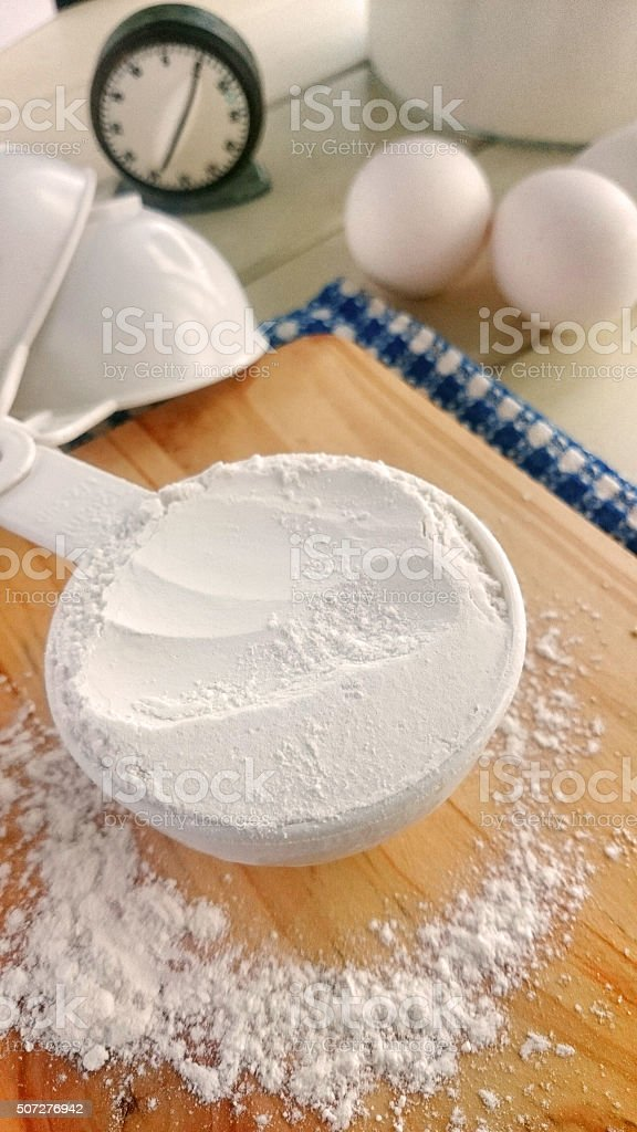 Flour for baking in measuring cup. stock photo