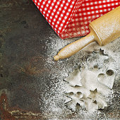 Flour, rolling pin and cookie cutters. Christmas food