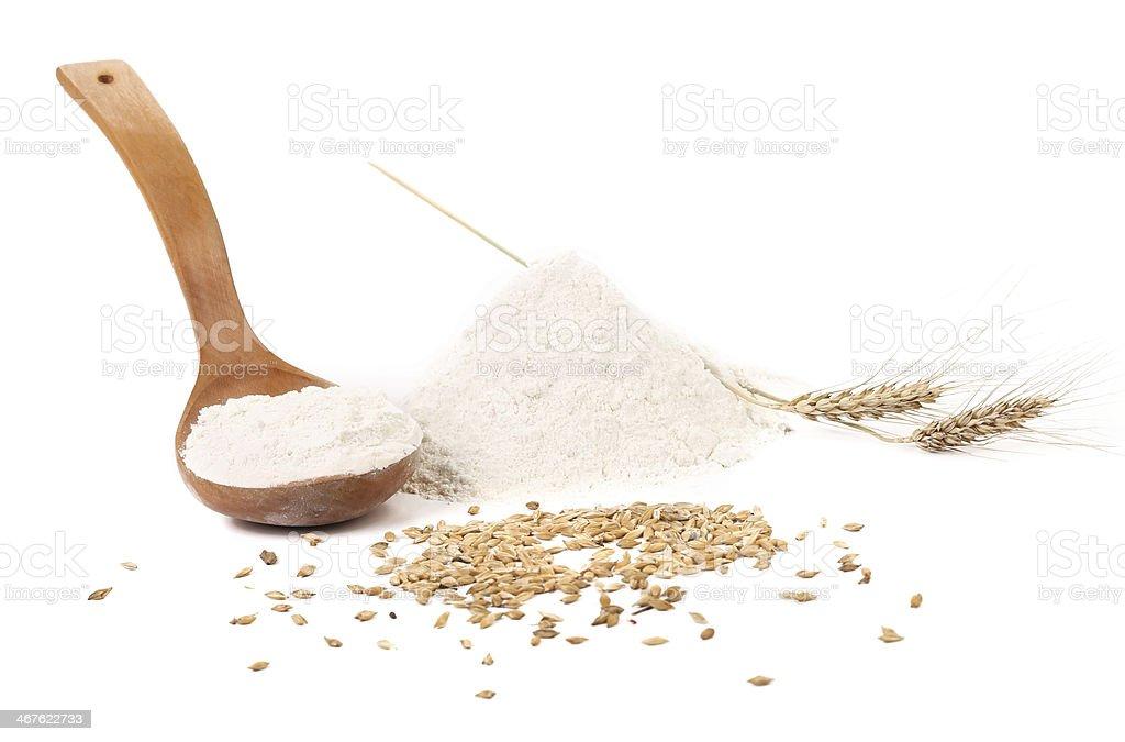 Flour wheat ear and wood spoon. stock photo