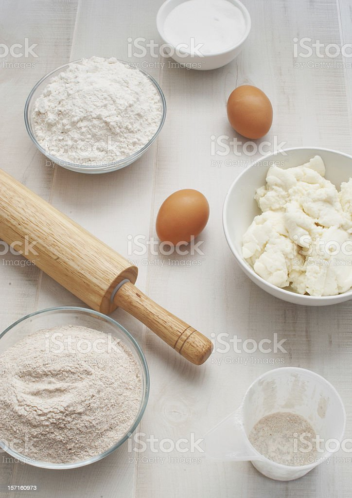 Flour  with eggs, ricotta cheese and rolling pin stock photo
