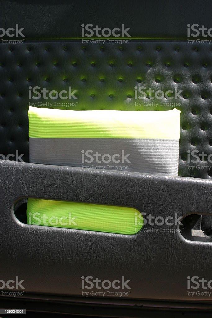 Flourescent Jacket in Door Pocket Vertical stock photo
