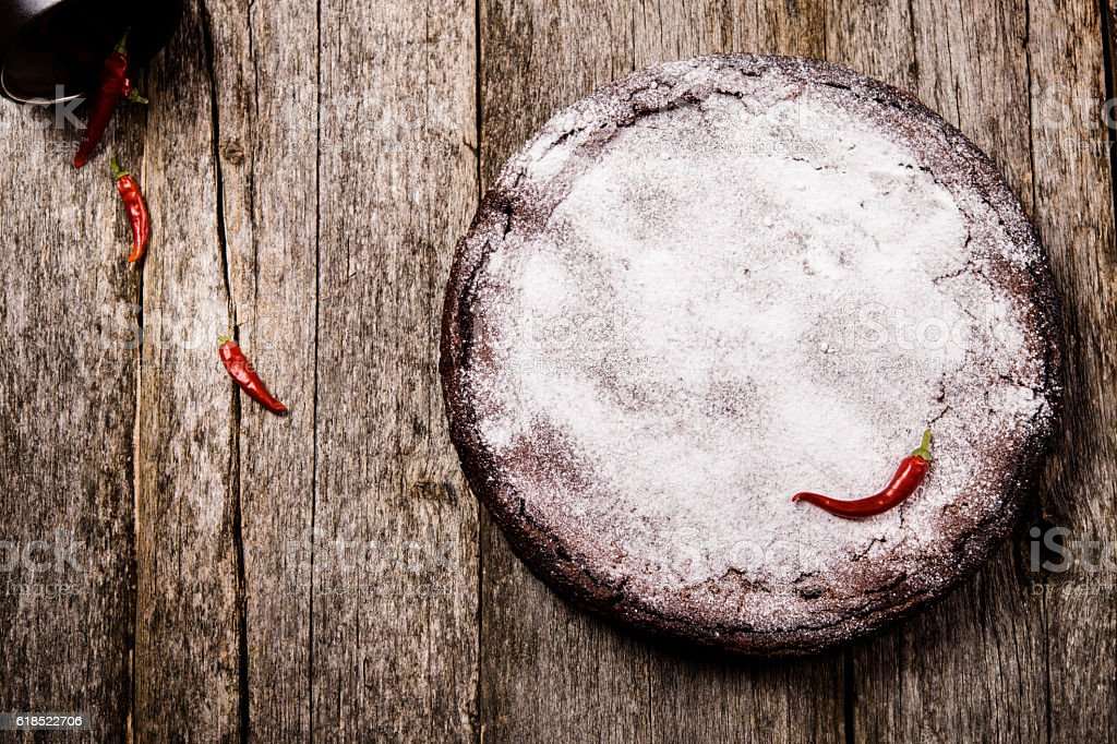 Flourless chocolate cake with red hot pepper stock photo