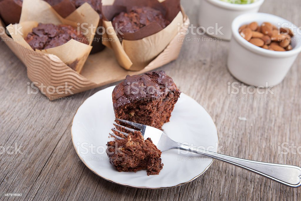 Flourless chocolate courgette muffins on a wooden table stock photo