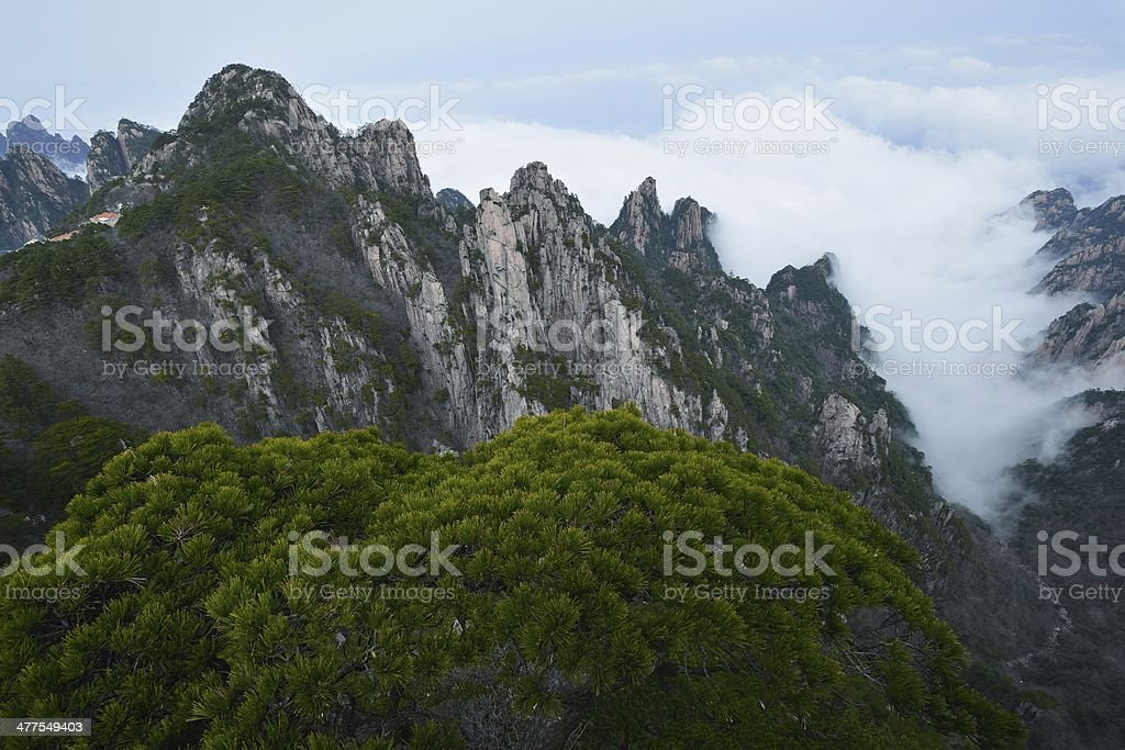 Flow of clouds in huangshan mountain valleys 001 stock photo